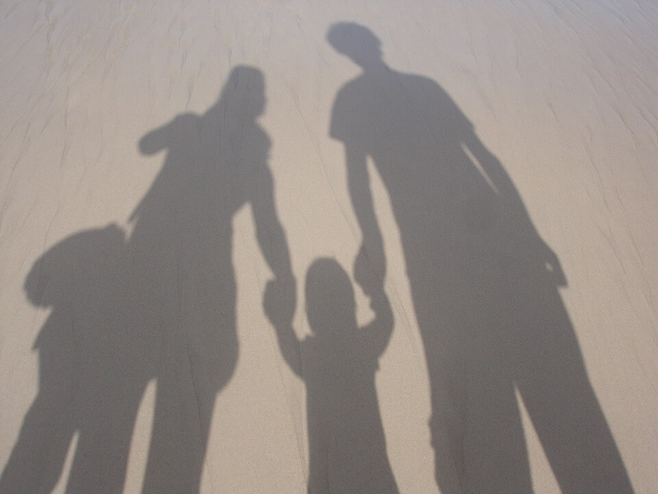 shadow outline of family holding hands